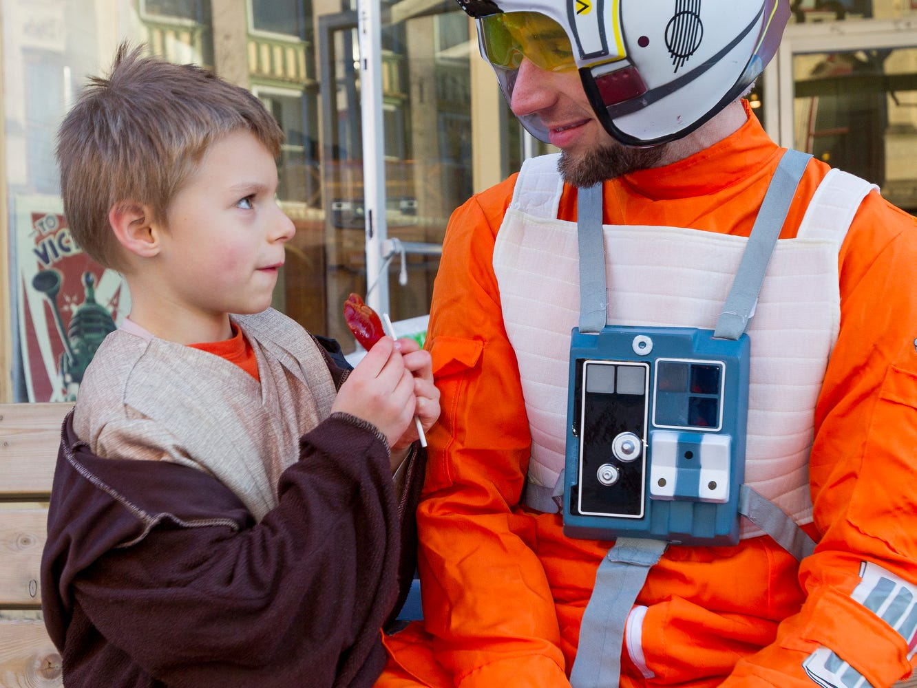 2015: Six-year-old Zeke Sopchak, as Obi-Wan Kenobi, talks with his father, Mason, as Luke, Friday afternoon during trick or treating in the Downtown stores on The Commons.