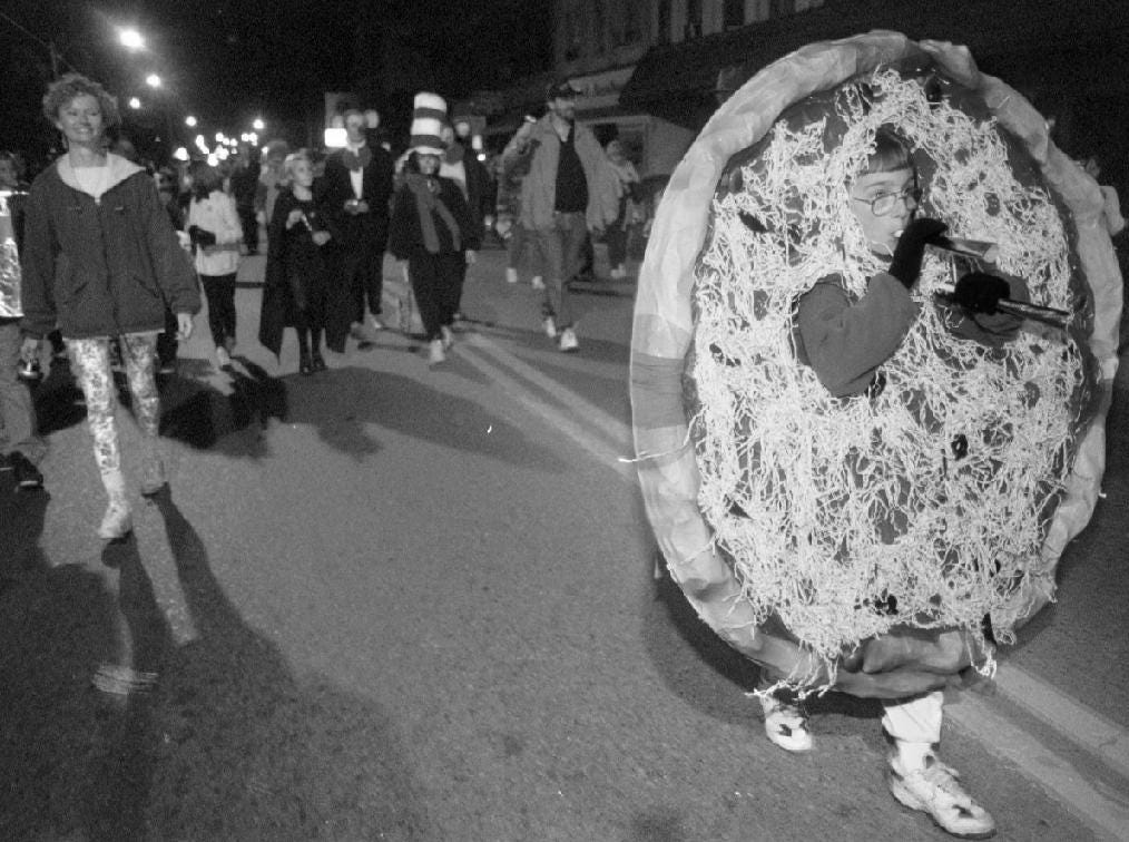 1997: Giant pizza Timothy Kapuscinski, 9, of Owego marches in the Owego Halloween Parade Friday night.