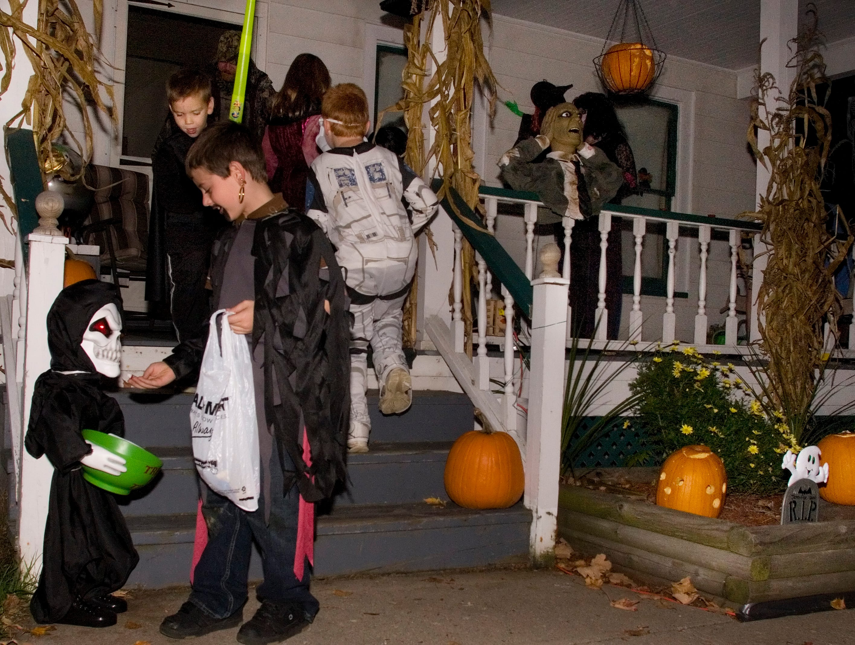 "2007: Patrick Bannon, 7, of Watkins Glen, dressed as ""Davy Jones,"" admires the decorations at the Cruttenden residence on Porter Street in Watkins Glen as Walker Richtmyer, 6, of Watkins Glen, dressed as Darth Vader descends the stair his brother Chase, 9, dressed as a clone trooper, center, prepares to collect candy during trick-or-treating in Watkins Glen."