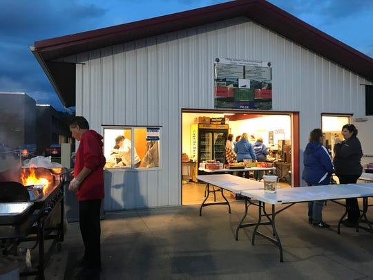 Laura Wasyln runs Owego Free Academy's concession stand beside the school's football team.