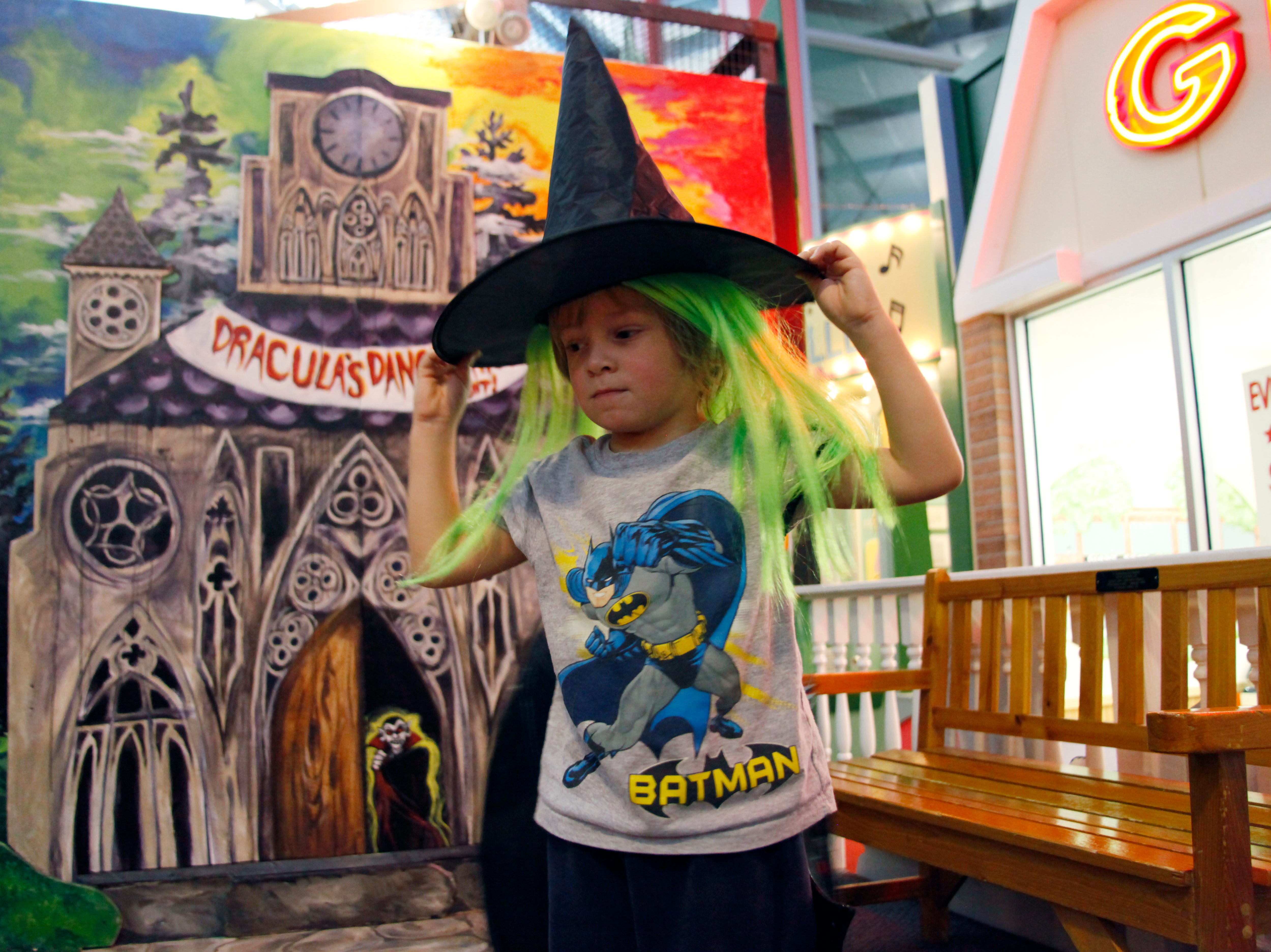 2011: Four-year-old Sawyer Benedict places a witch hat on his head at the Discovery Center on Tuesday afternoon in Binghamton. The Discovery Center has created a large Halloween display that opened on October 1st and supports a whimsical theme catering to children of young ages.