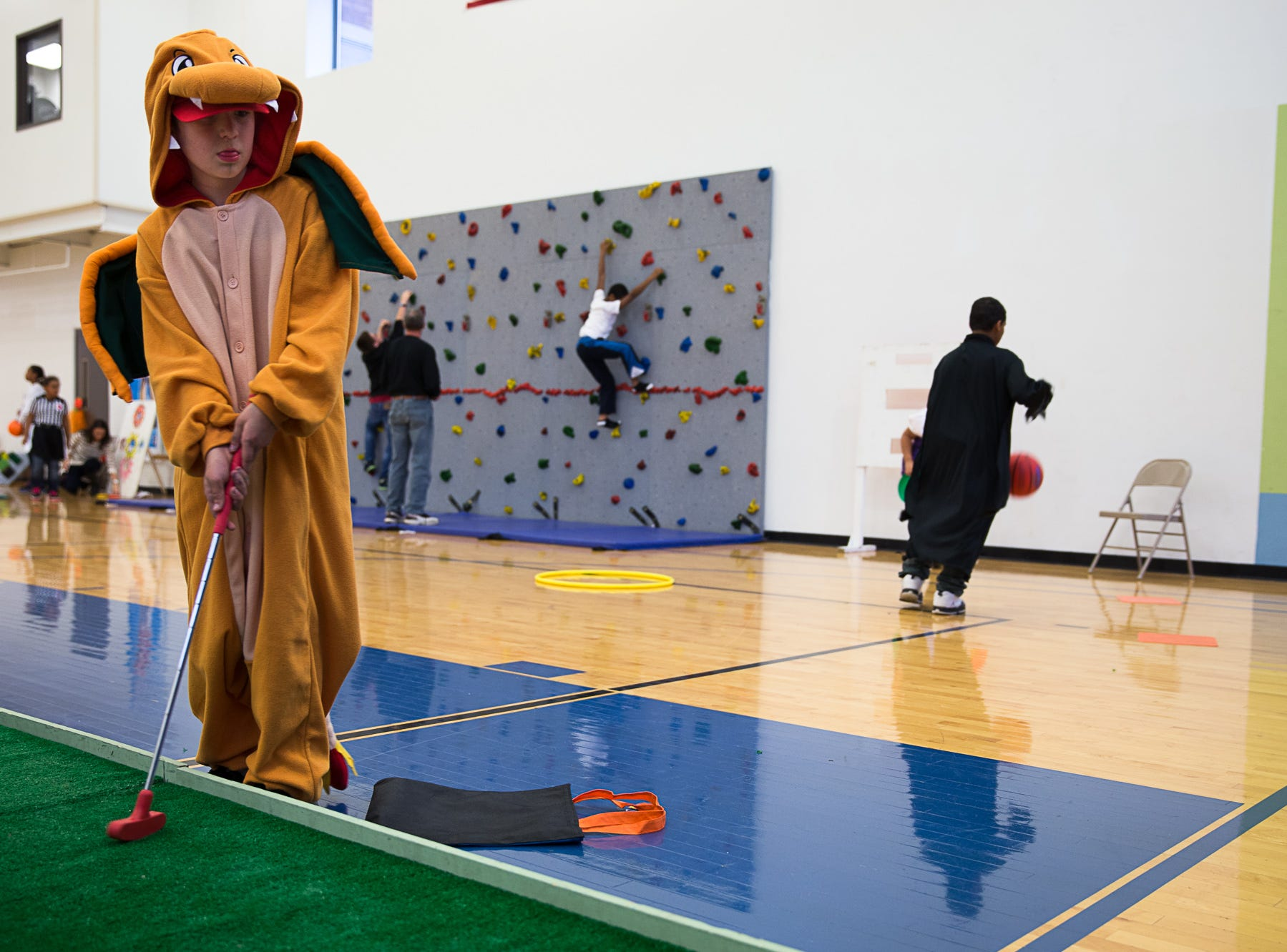 2013: Aidan Ehmke, age 9 of Binghamton, plays a golf game to earn tickets for candy and toys.  The Boys and Girls Club hosts a night of Halloween activities for children, including games, candy, food and a haunted house.