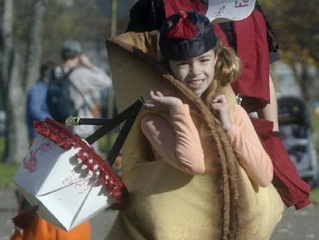 2004: Lucy Wales, 8, participates in the Annual Halloween Parade wearing a fortune cookie costume Sunday at Highland Park in Endwell. Lucy came up with the idea for the costume after last year's parade. The idea proved to be a good one as Lucy won this year's halloween costume contest for the 4-8 age group.