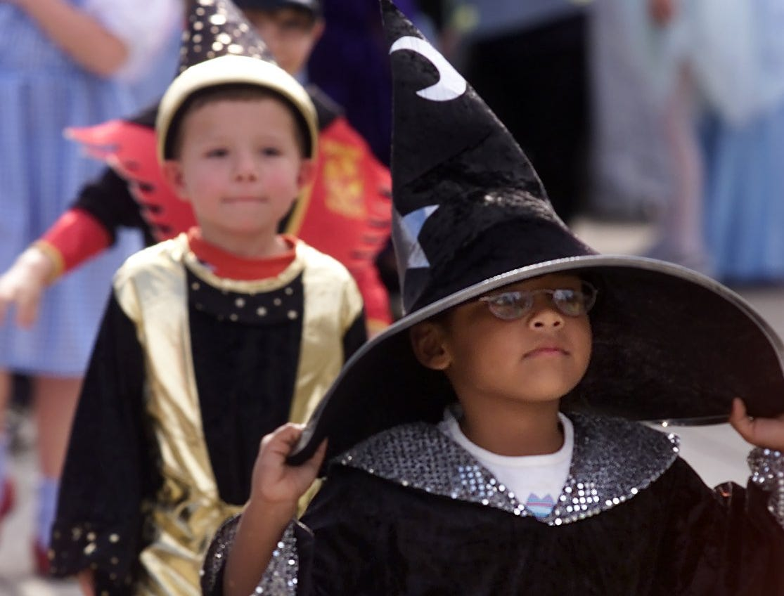 2003: Cohen Elementary School students parade in their Halloween costumes outside the school on Friday October 31, 2003.