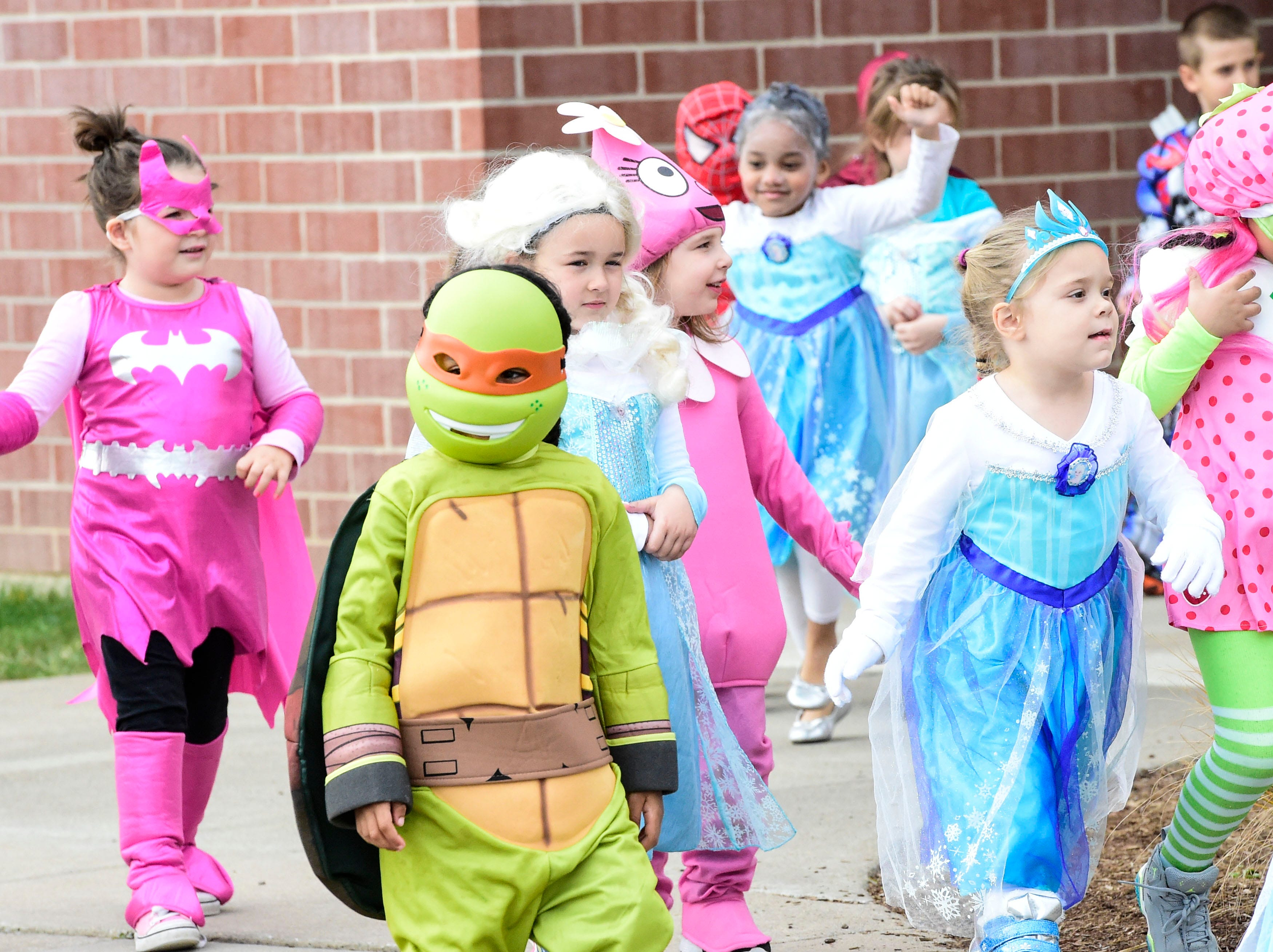 2014: Students ranging from kindergarten to third grade at George F. Johnson Elementary School show off their Halloween costumes during an annual parade on Friday.