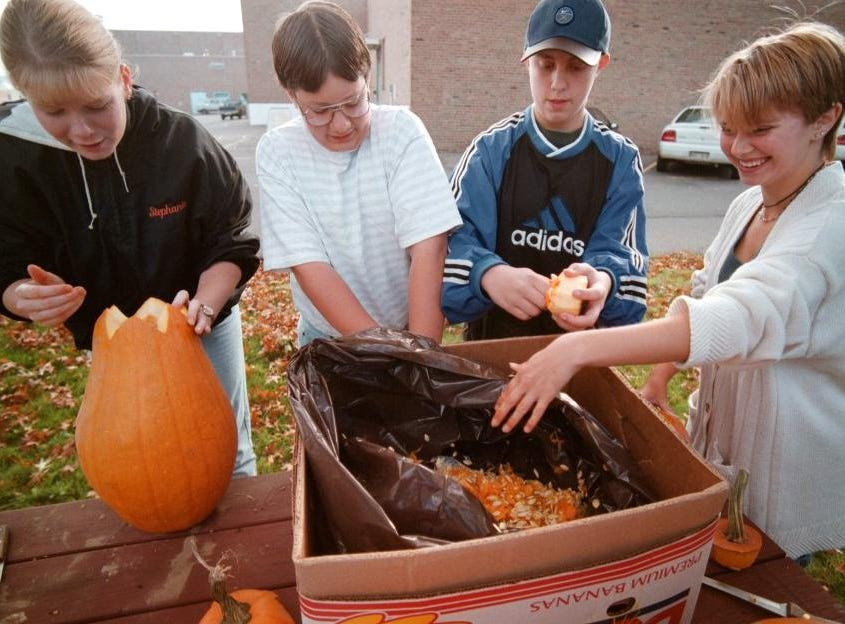 1997: Teens in the Tier reporters begin the process of carving pumpkins early on a Saturday morning.