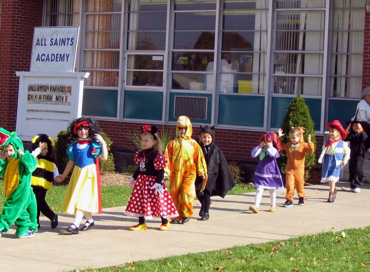 2004: Costumed youngsters march Friday in the annual Halloween Parade at All Saints Academy in Corning. About 80 preschoolers through third-graders took part in the parade, Principal Rose Ann Ewanyk said. Second-graders dressed up as saints, and third-graders were dressed as nursery-rhyme characters or their favorite book characters, she said.
