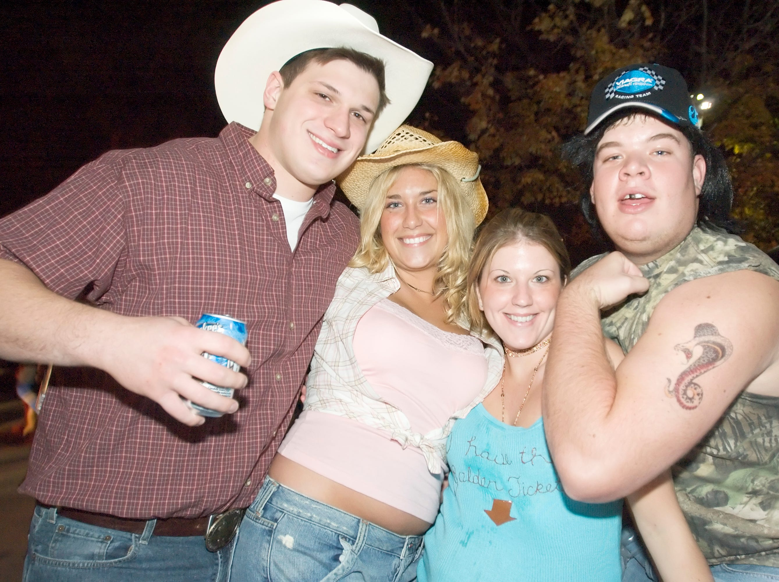2005: This is William Leone, Rachel Dickow, Kim DeLorenzo and Ed Washburn out side the Phi Kappa Psi Halloween party.  Check out Washburn's cobra tattoo... little touches, little touches.