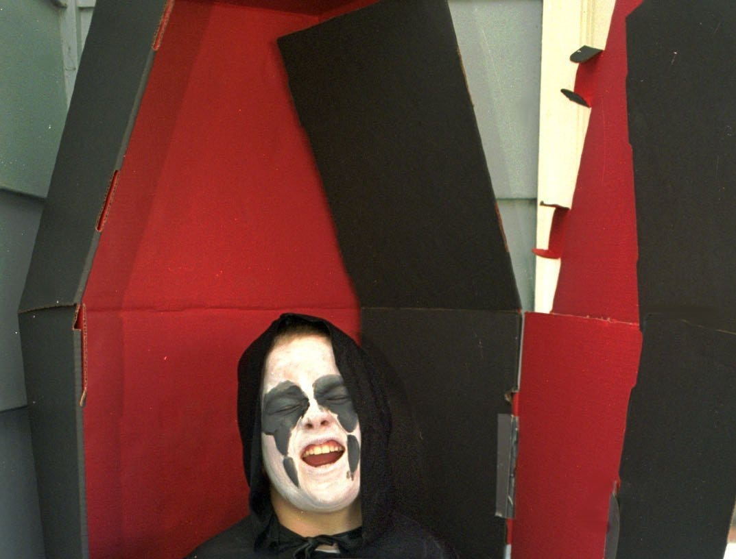 1998: Above, 10-year-old Matt Hoobler of Big Flats - otherwise known as the grim reaper - is ready for Halloween with his 5-foot plastic scythe ($1.99) and build-it-yourself cardboard casket ($19.97 at Wal-Mart)..