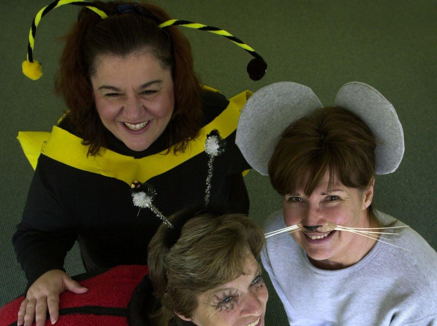 "2002: Office workers Michelle Dunn dressed as a bee, lady bug Christine Tymeson and the mouse, Diane Kadleick are having fun dressing up for Halloween Thursday at Burke Pest Control in Conklin. ""Itàs dangerous being here dressed like a bug,"" Dunn said surrounded by pest exterminators."