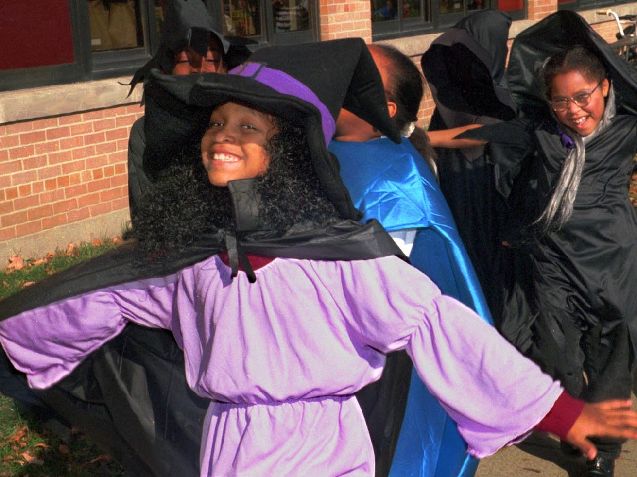 1998: Nishelle Brooks, 8, shows off her witch outfit as she marches around Booth Elementary School with her classmates Friday afternoon.