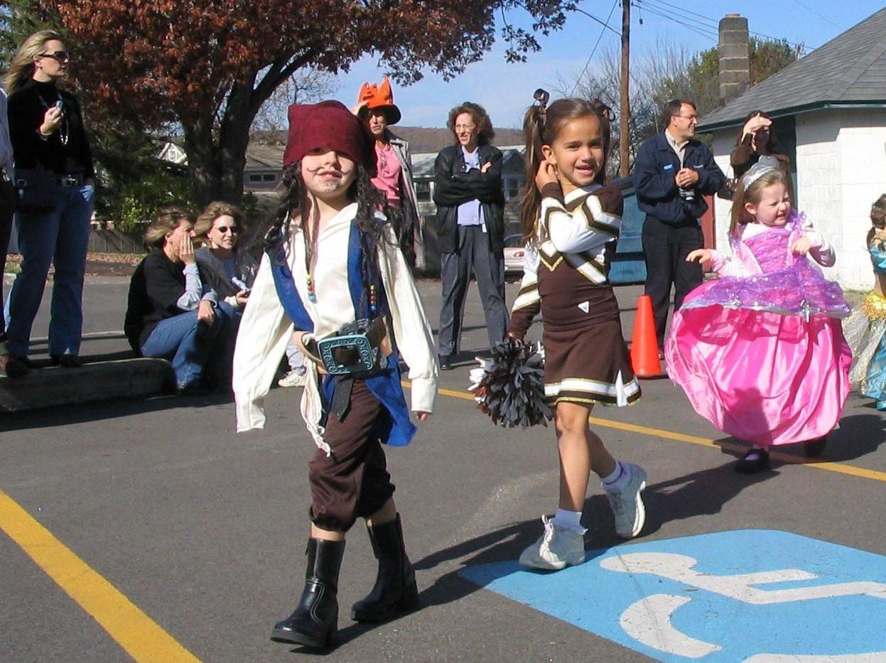 2007: Lauren Hill (left) leads four other students through the parking lot at the Brennan Center during the annual All Saints Academy Halloween parade in Corning. Following her, from left, are Madeline Burns, Ashley Brown, 