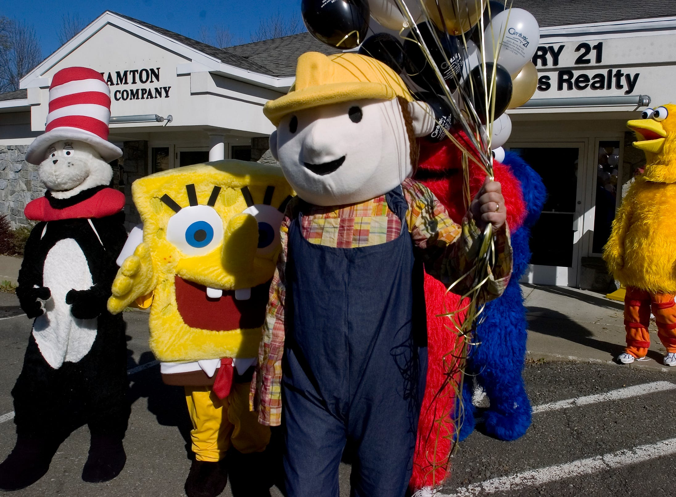 2008: Agents and staff with John Burns Century 21 Realty, dress as cartoon characters leave their Vestal offices on Friday to visit the pediatric unit at Lourdes Hospital for Halloween.