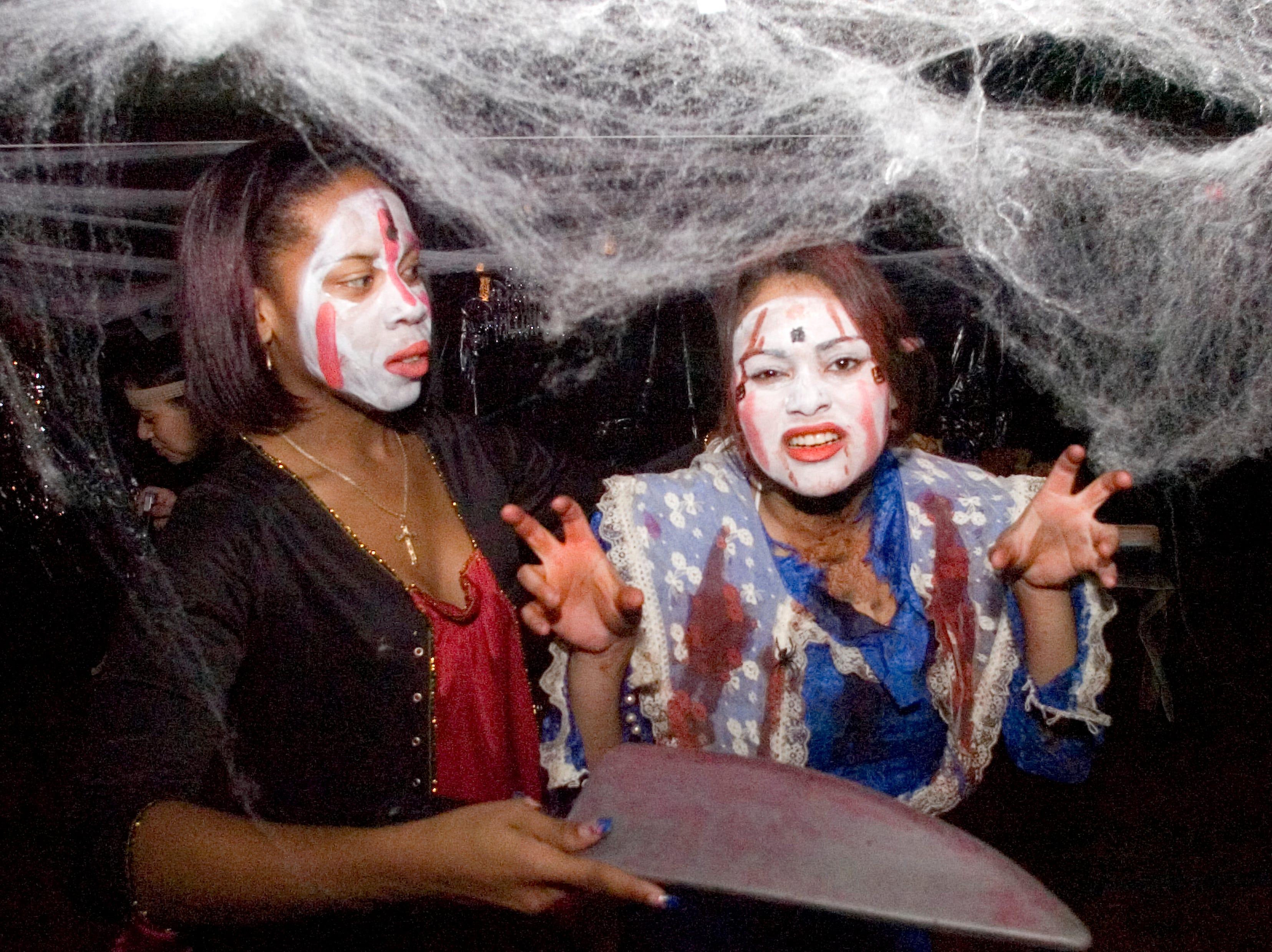 2005: Shakima Brown, left, and Irene Agron, teenage members of the Boys & Girls Club of Binghamton, participate in a haunted maze Wednesday evening at the club's facility in Binghamton. This is the third year the club has offered a haunted tour that was followed by a dinner and in-house trick-or-treating.