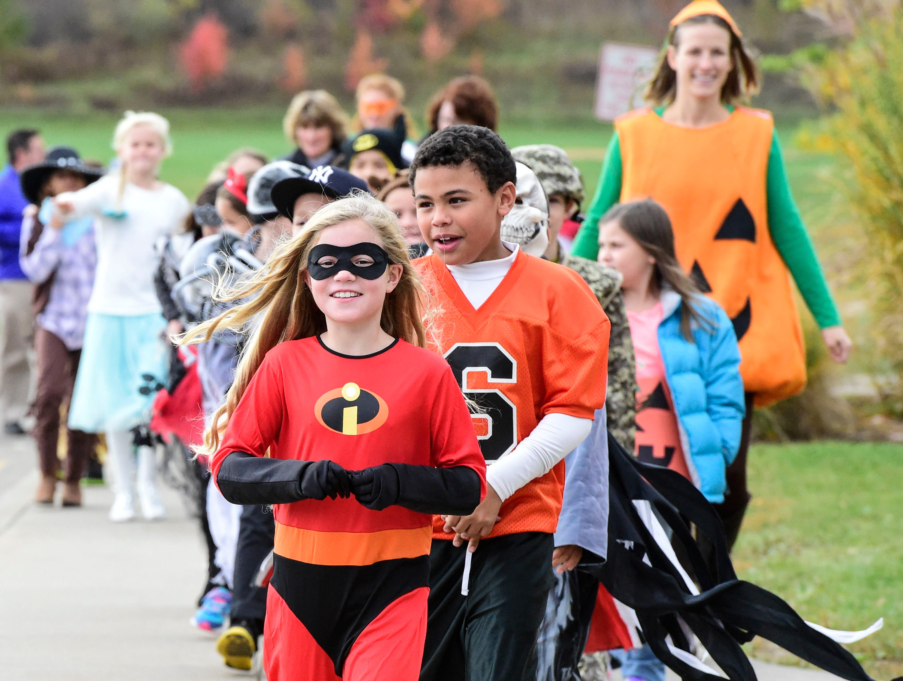 2014: Veronica Bowman, a third-grade student at George F. Johnson Elementary School, dresses like on of ÒThe IncrediblesÓ during an annual Halloween parade on Friday.