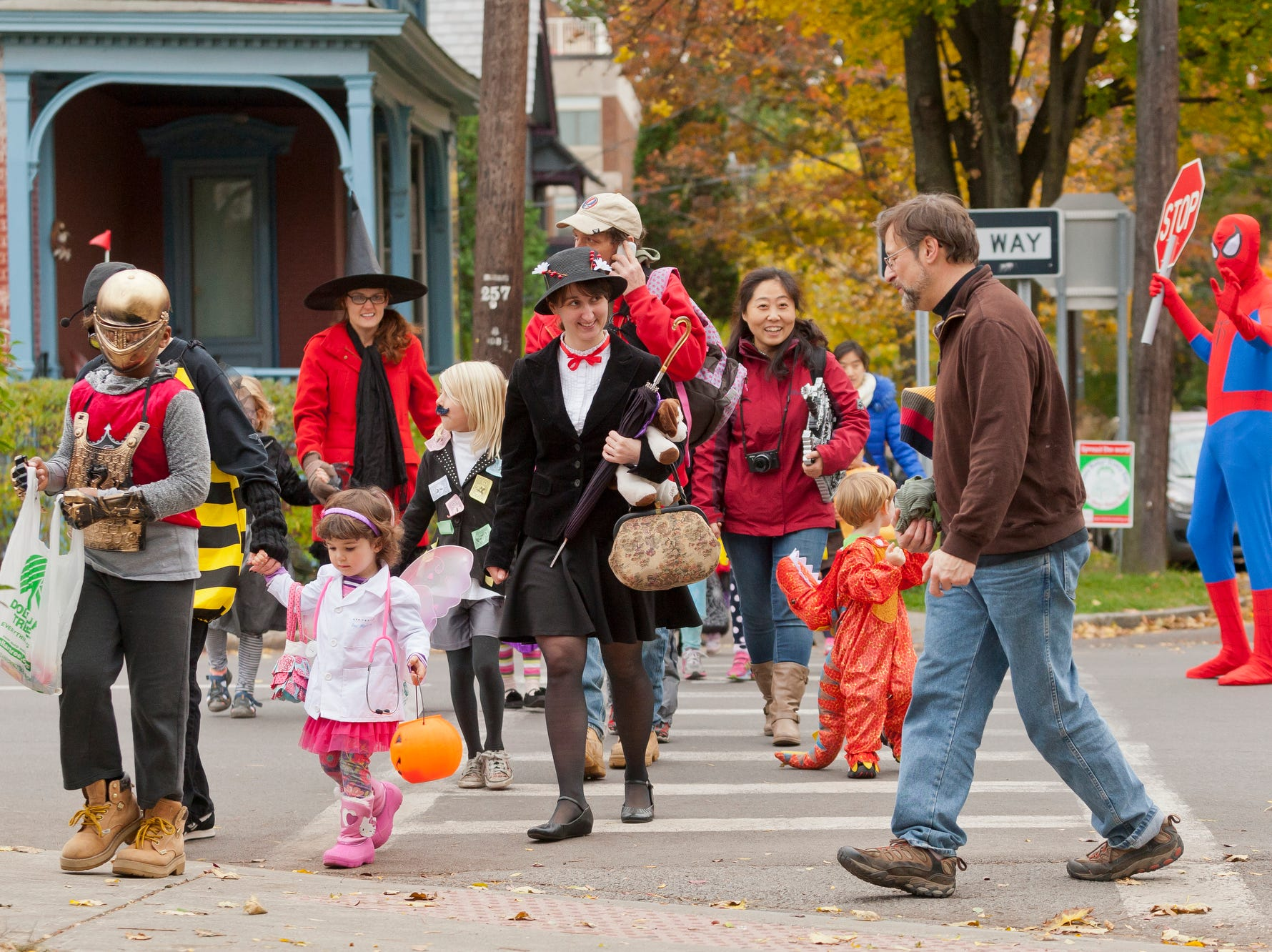 2014: More than 200 parents and children participated in the annual Downtown Halloween Parade Thursday in Ithaca. The parade travelled from the Greater Ithaca Activities Center to McGraw House and then onto The Commons for trick or treating, games and food in Center Ithaca.