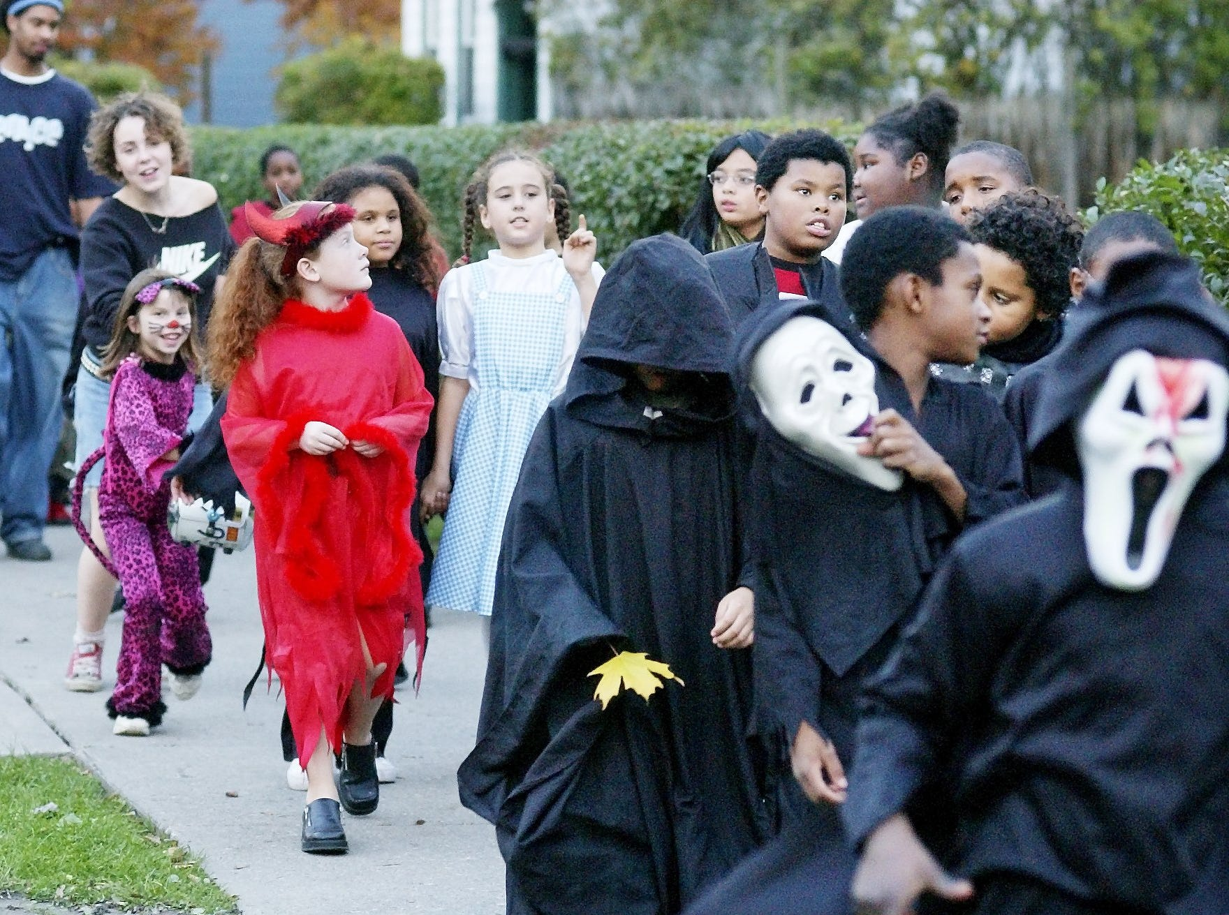 2003: Children dressed up in Halloween costumes parade east Friday on Buffalo Street during GIAC's Annual Parade and Party. After the parade, the children got packets of candy.