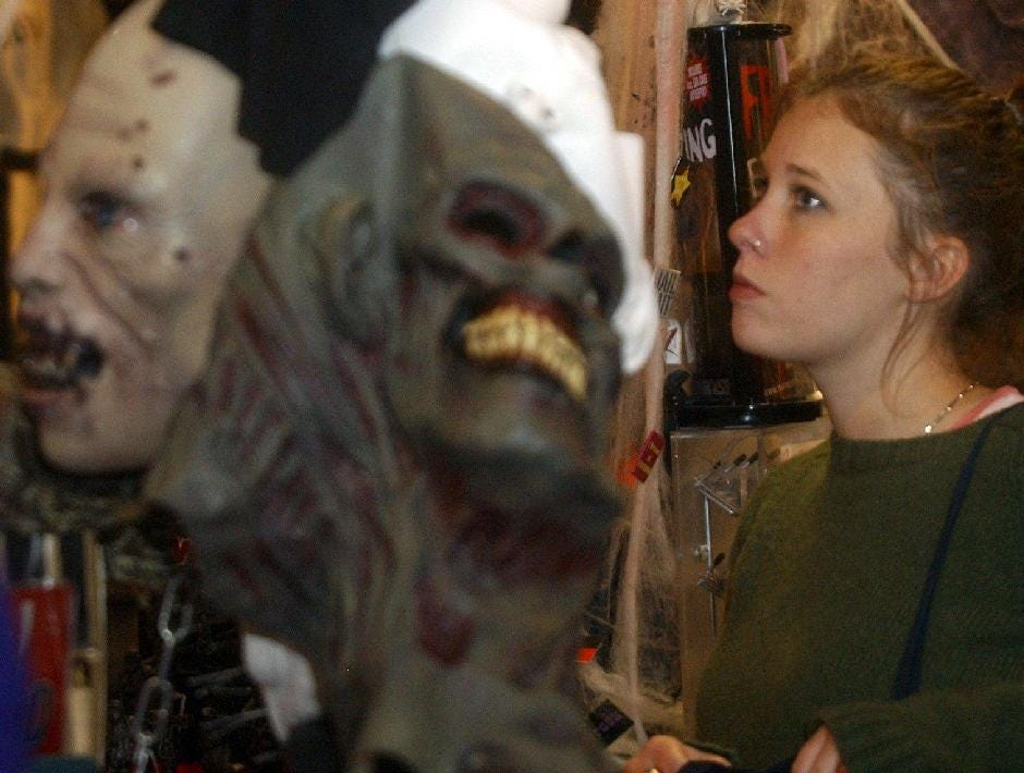 2004: Betsey Fundas looks at Halloween items at Spencer's Gifts in the Oakdale Mall.