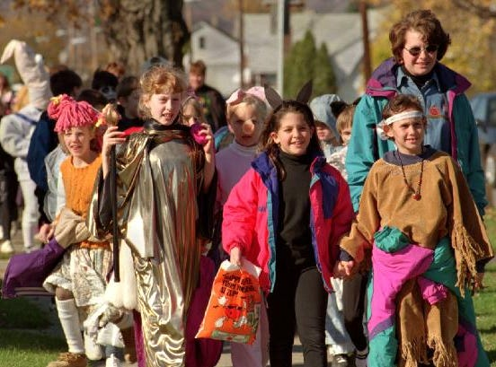 1996: The entire Blessed Sacrament School student body marched down Riverside Drive in Johnson City in full costume Thursday afternoon.