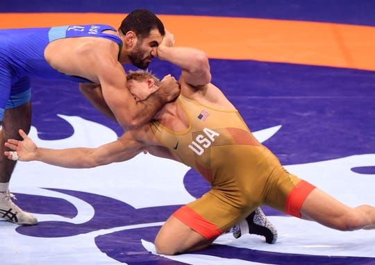 Kyle Dake and Azerbaijan's Jabrayil Hasanov compete Oct. 22 during the final of the men's freestyle 79kg category at the World Wrestling Championships in Budapest, Hungary.
