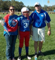 From left: Laura Wasyln, Michael Wasyln and Jeff Wasyln on Michael's last game of youth football. Michael was 12 years old at the time.