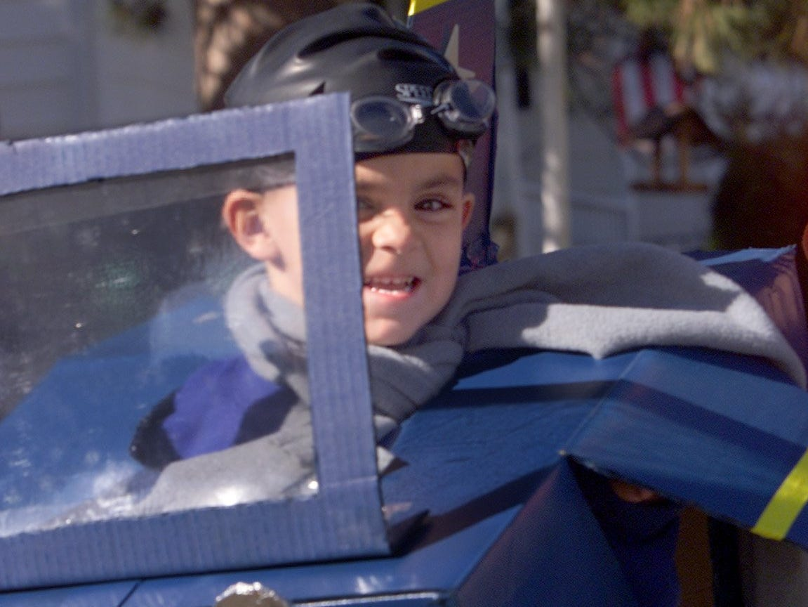 2000: Joseph Hitchcock, 4, of Elmira, a student in Carol Griffin's kindergarten class at Washington Elementary School, peeks out from behind the windshield of his homemade cardboard airplane Tuesday during a Halloween parade at the Elmira school. All students in the school took part in the parade Tuesday afternoon.