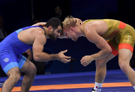 Kyle Dake, right. and Azerbaijan's Jabrayil Hasanov compete during the final of the men's freestyle 79kg category Oct. 22 at the World Wrestling Championships in Budapest, Hungary.