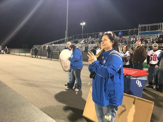 Laura Wasyln looks on as Owego Free Academy's varsity football seniors are recognized on Oct. 19.