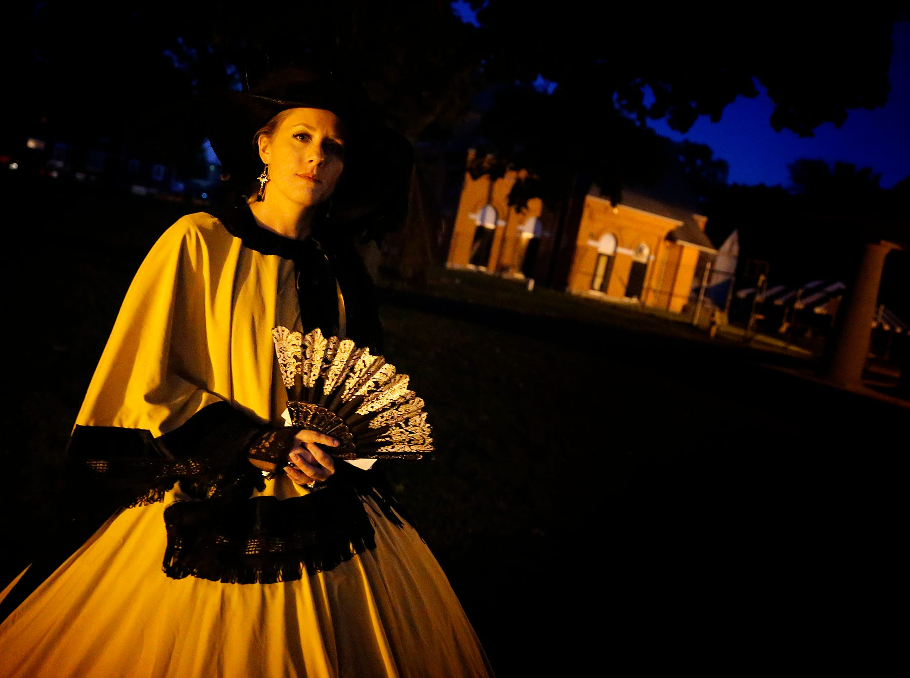 2016: Dressed in a remake of a Civil War-era dress, Michelle Bertron, of Elmira, stands in the foreground of the former Elmira Civil War Prison Camp. Bertron led walks around the campus in mid-October, detailing numerous ghost stories.