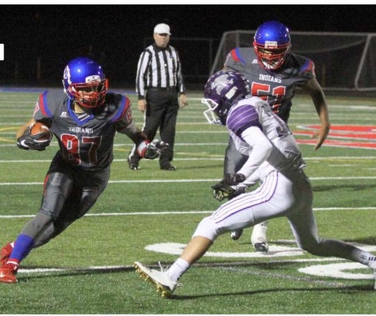 17-year-old Michael Wasyln (#87) runs to make a touchdown against Norwich at Owego on Oct. 19. The Owego Indians went on to defeat Norwich 24-13.