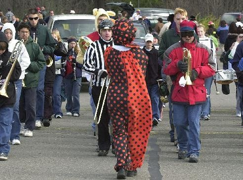 1999: Costumed members of the Maine-Endwell High School Marching Band lead the parade of costumes from the high school to Highland Park for hayrides, a haunted house, and costume judging Sunday.