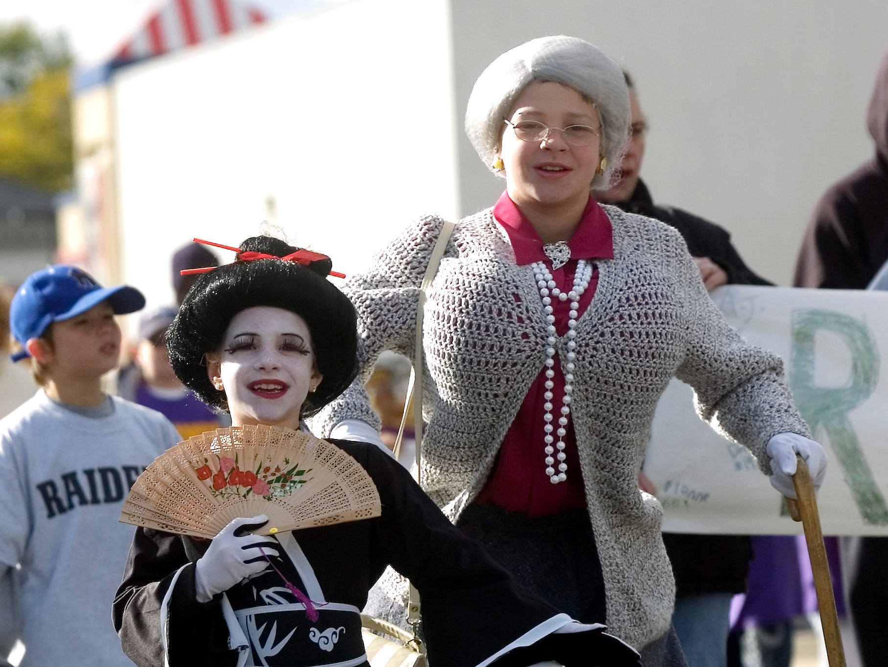 2006: Siblings Brittany DeSario, 7, of Binghamton, left, and Tyler DeSario, 10, dress as a geisha and a granny for East Side Youth Association's annual Halloween parade on Robinson Street in Binghamton.