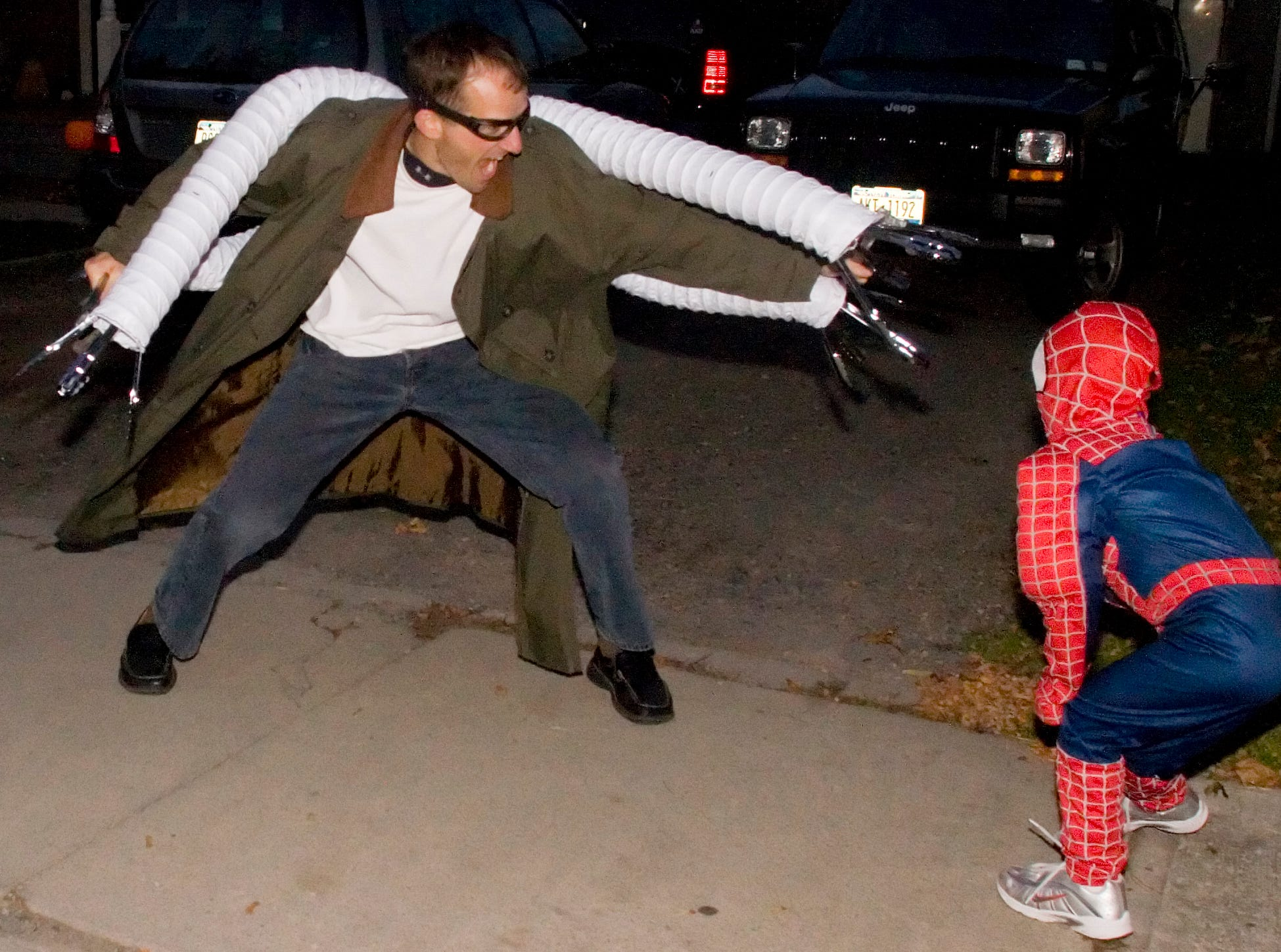2007: Trevor Holland, 35, of Hector, dressed as Doctor Octopus, left, plays with his son, Elliott, 6, dressed as Spider-Man, on Perry Street in Watkins Glen.