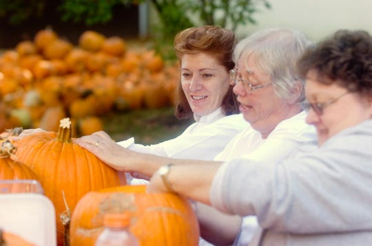 2008: Volunteers from Lockheed Martin Monica Hallman, from left, Bonnie Orr, and Irene Brooks carve pumpkins for the Binghamton Zoo at Ross Park Wednesday in Binghamton. The pumpkins will be use as decoration for the zoo's annual Boo at the Zoo, which will be held Friday and Saturday.