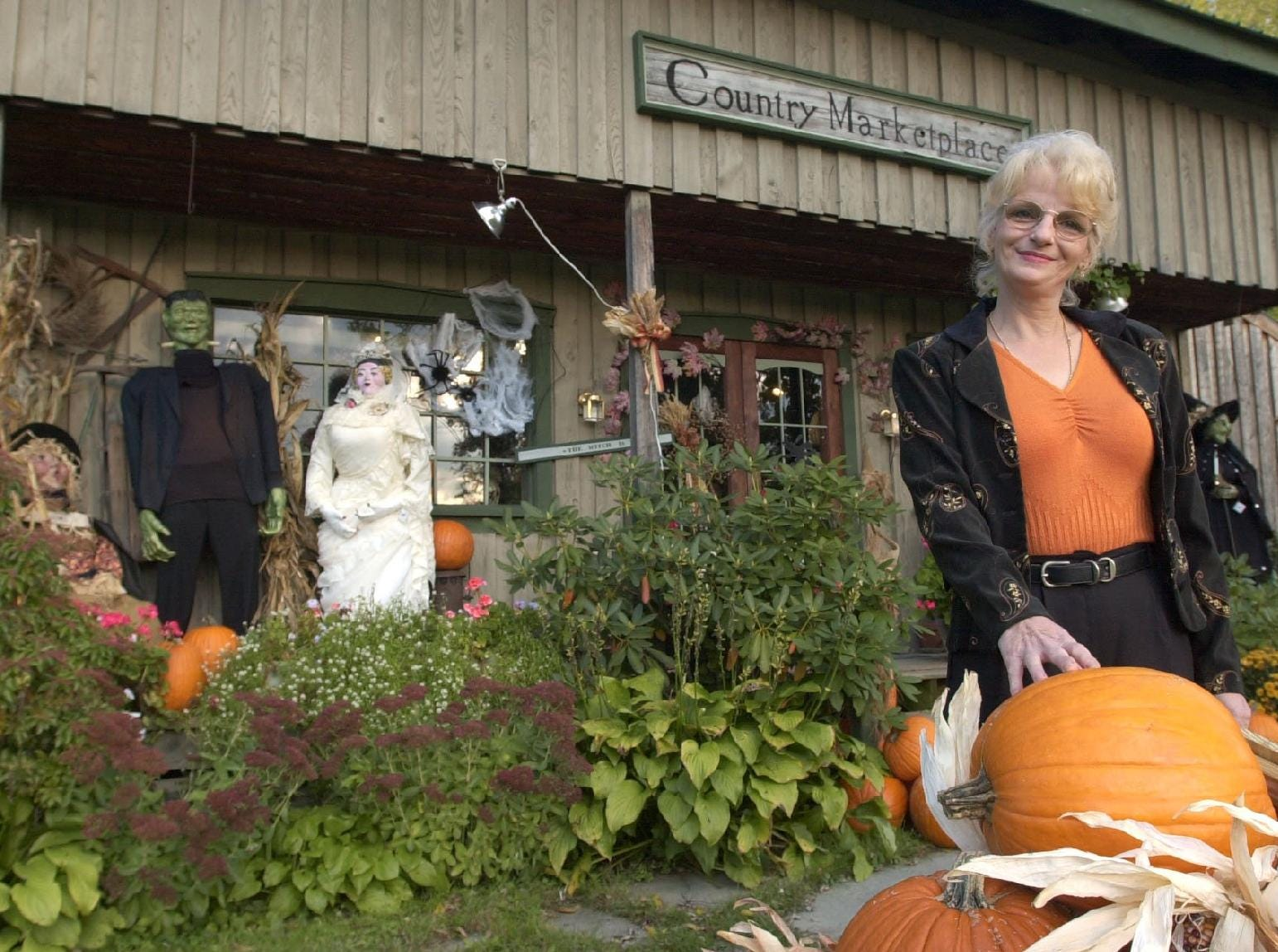 2002: Frances Conklin has created a Halloween display at Country Marketplace in Kirkwood.