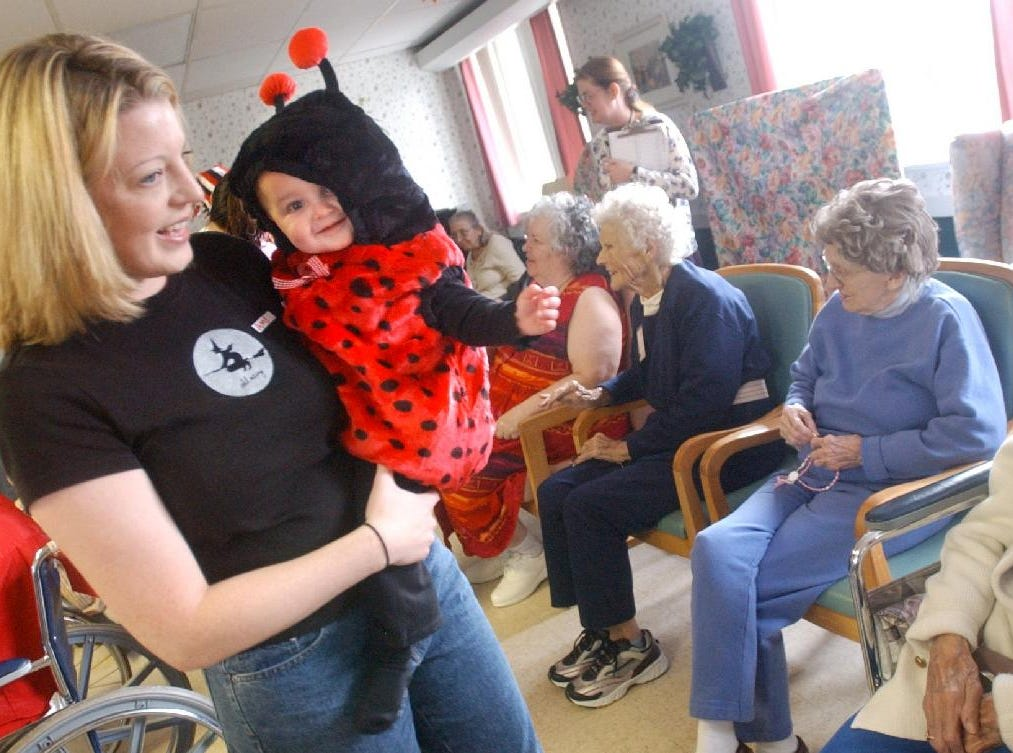 2004: Amy Dando of Endicott and her daughter Sophia Dando, 11 months old, during the Halloween Parade at Susquehanna Nursing Home in Johnson City on Monday. Members of the Baby Brigade, one of the activities of Mother's and More, visit the nursing home every six weeks, said Kristin Olson of Vestal, who helped organize the parade.