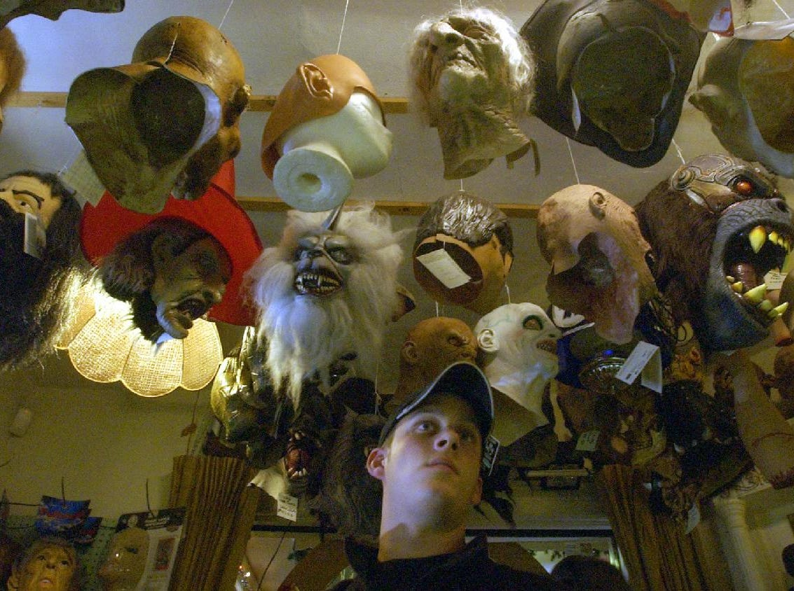 """2004: Chris Lemmon of Vestal looks around for Halloween costumes at Showtime Costumes in Binghamton Friday. """"I'm just looking around for ideas (for halloween),"""" said Lemmon. The establishement has been getting more business with Halloween just around the corner. Costumes are available for rent or sale at the Main Street store."""