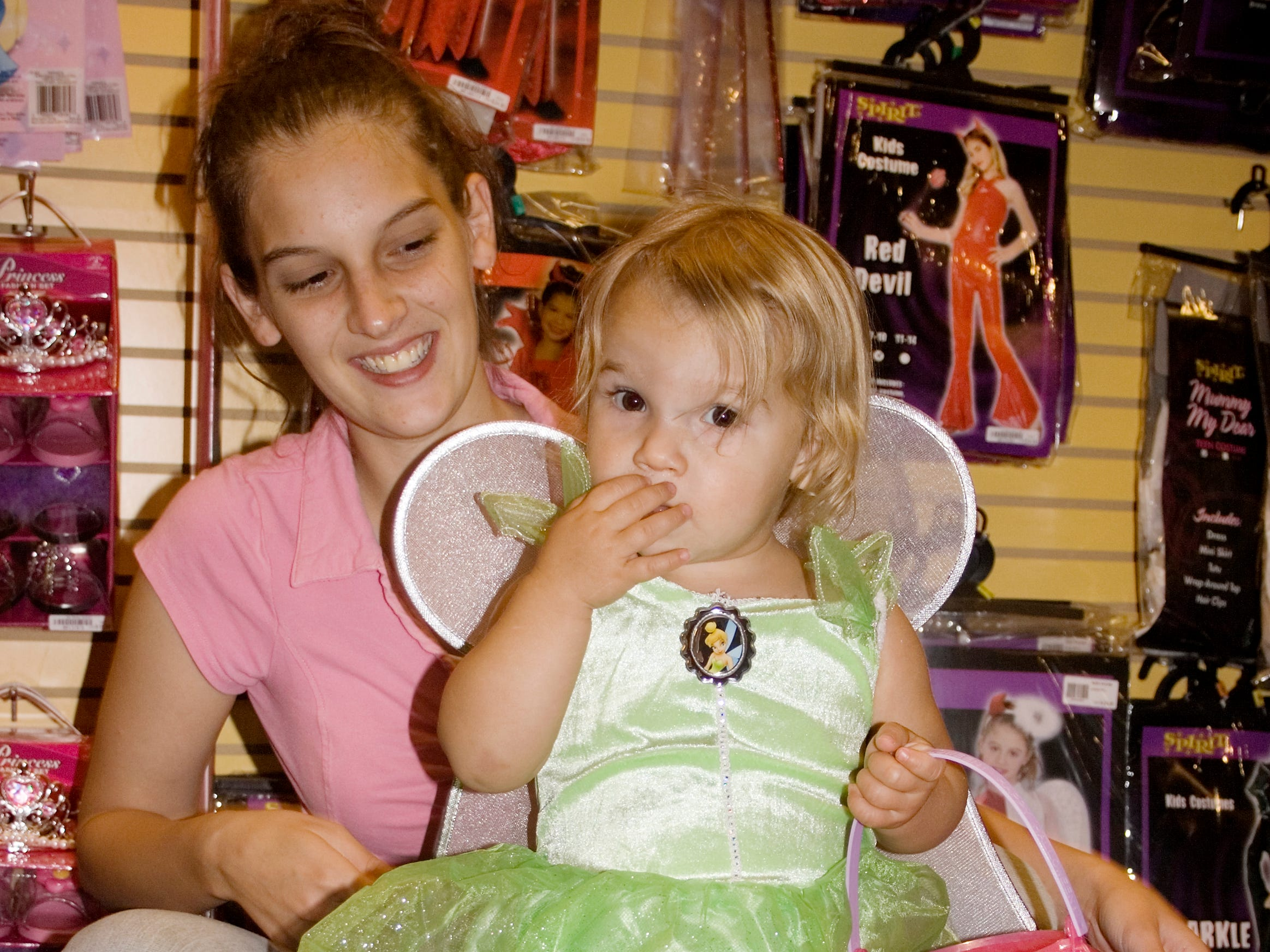 2007: Mackenzie Yale, 18 months, picked out a Pixie costume with her mother, Jennifer Yale, of Waverly, Thursday morning at the Spirit Halloween Superstores shop at the Arnot Mall in Big Flats.