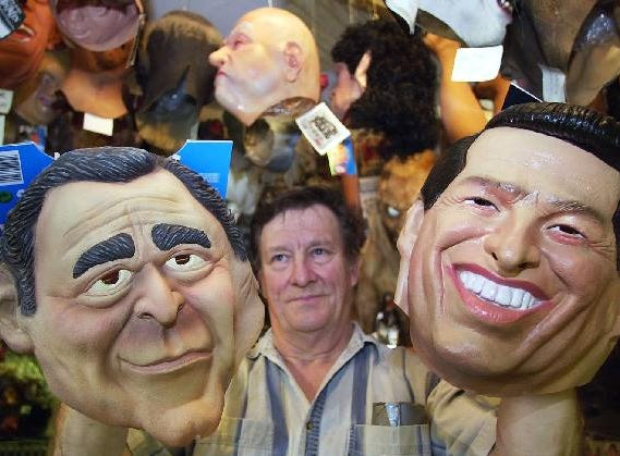 2000: Ron Striss, owner of Showtime Costumes, 142 Main St., Binghamton with the Bush and Gore masks that are selling for Halloween.
