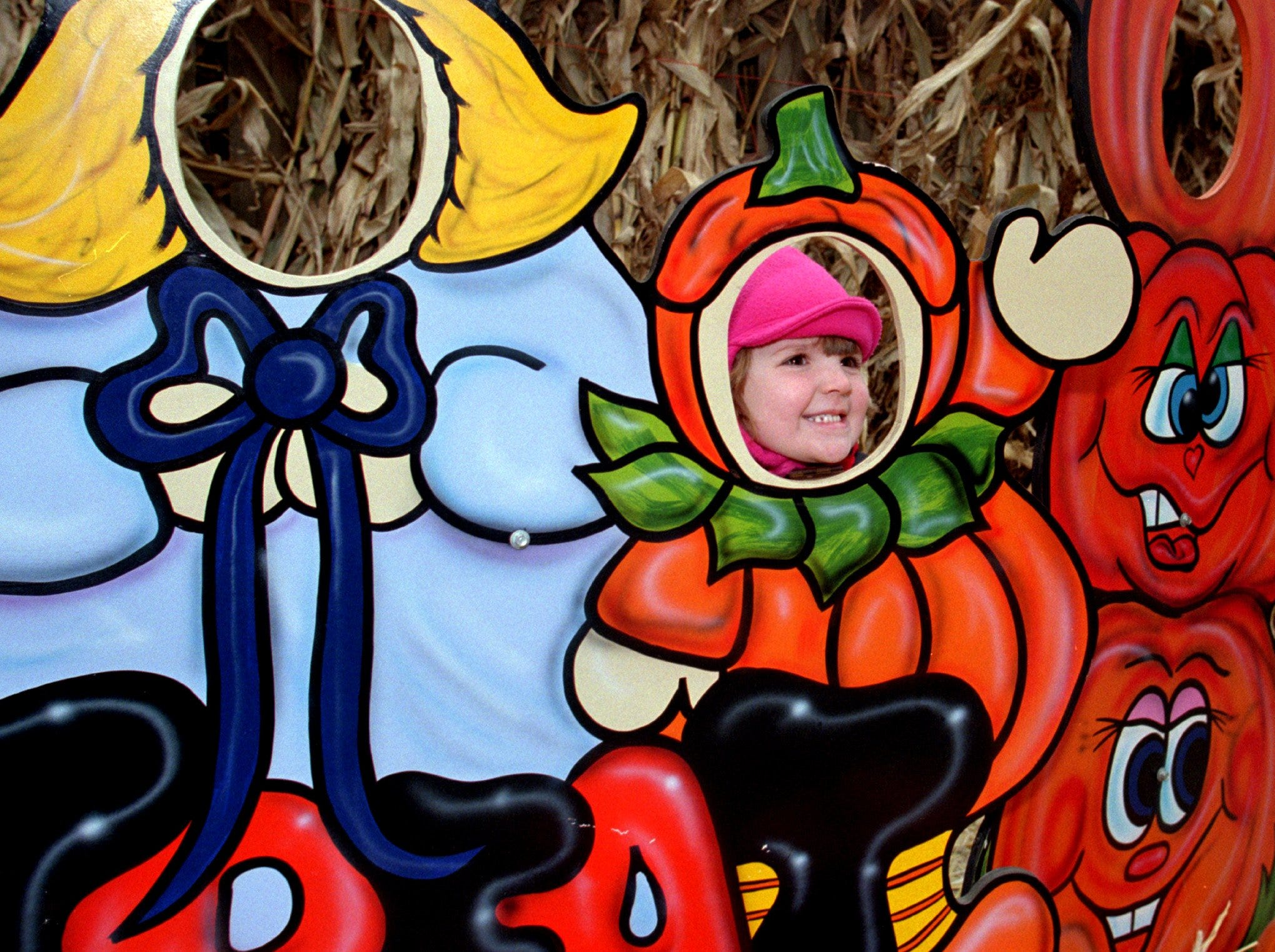 1999: Morgan Flanders, 3, of Schuylerville, pokes her face into a pumpkin cutout at Bradley Farms on chilly Sunday afternoon. She visited Bradley Farms' pumpkin patch and Halloween scenes on a trip to visit her aunt, Alyce Adair of Elmira.