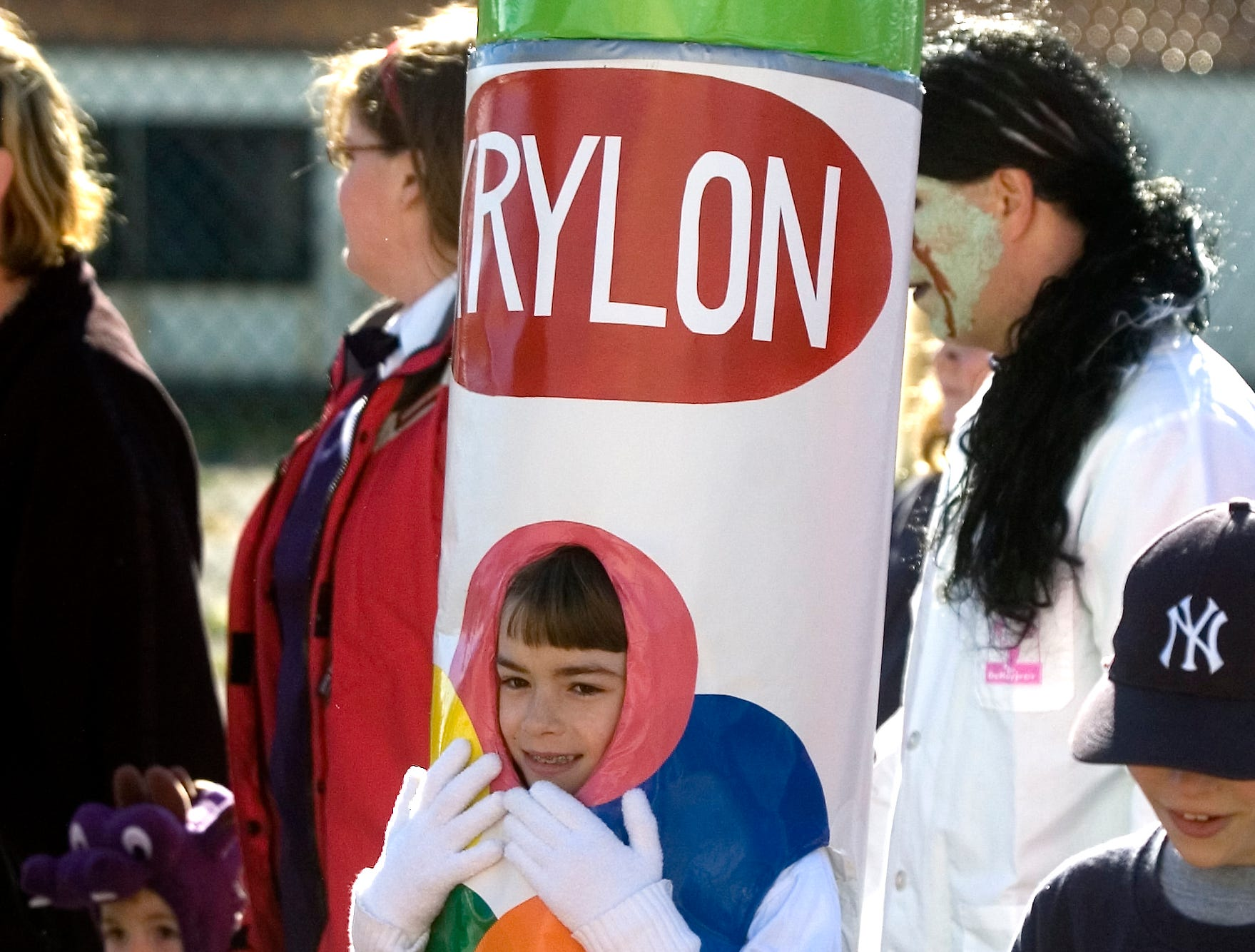 2006: Lucy Wales, 10, of Endicott dons a lime green spray-paint can costume for the annual Halloween parade Sunday at the West Endicott Park in Endicott.