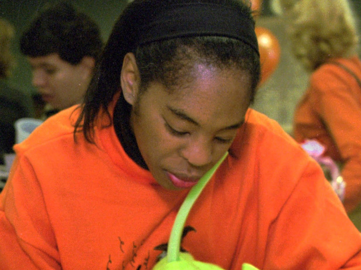 1998: Dwala Toombs, of Painted Post, helps her son Eric, 2, construct a paper pumpkin puppet at Halloween festivities during the 10th annual Northside Open House and Halloween Spooktacular in Corning Saturday.