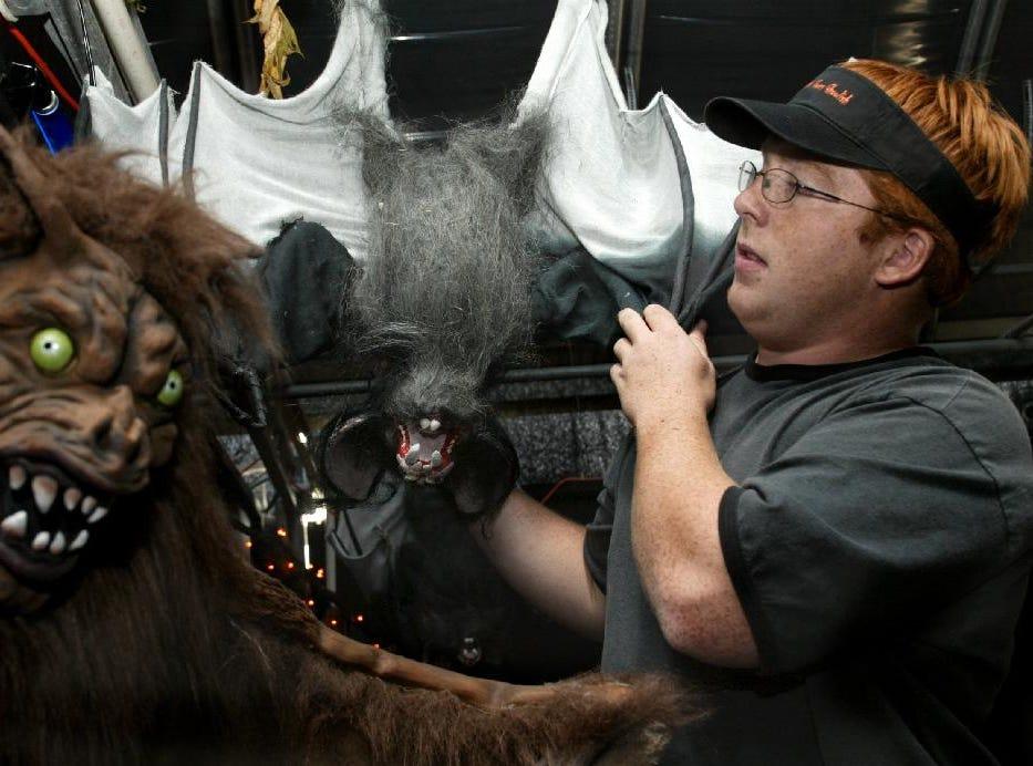 2003: Andrew Kuhlman of Owego an employee of Tioga Gardens fine tunes the bat room Friday, in Owego.