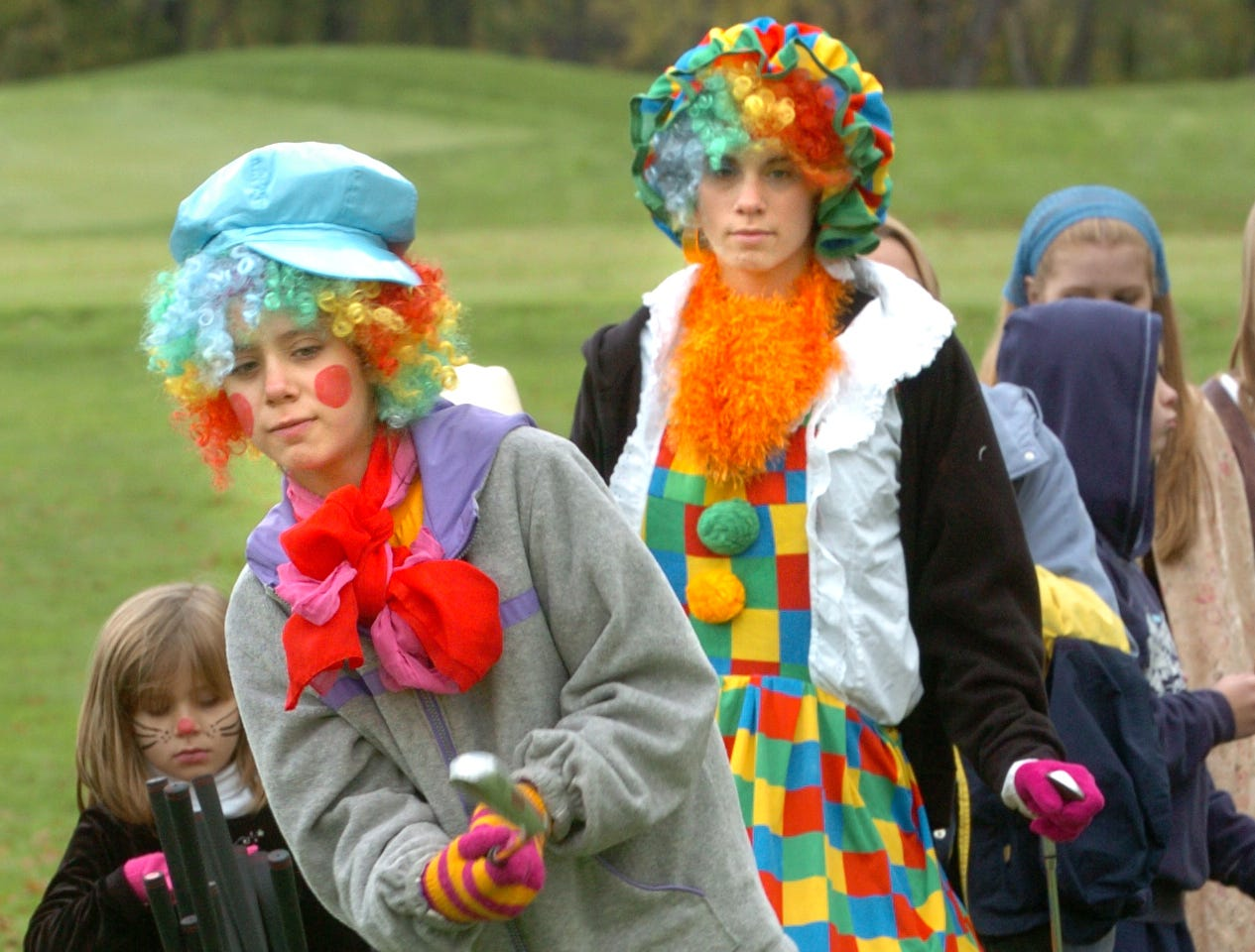 2005: Jenna Harmon, 10, of Endicott practices her chip shot while donning a clown costume Saturday morning during The First Tee of Hiawatha Landing's Halloween party. The event included skills training, a pumpkin run and a costume contest.