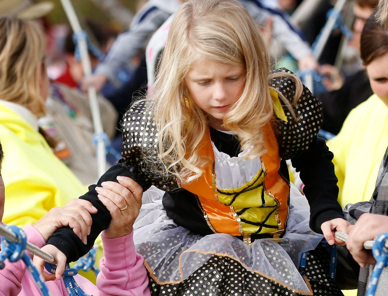 2015: Aubrey Stewart, 5, of Pine City, tests her rope-walking skills on a monkey bridge built Saturday morning by the Pine City Boy Scout Troop 43.