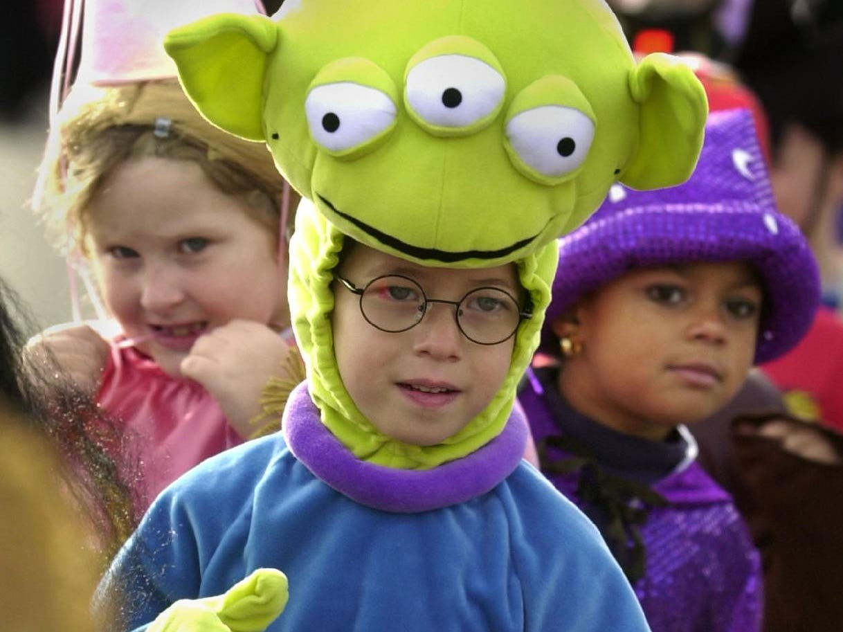 Kindergartener Anthony Micalizzi, 5, is a space alien as he marches with classmates, Holly Evans, left, and Takayla Carlin during the Brookside Elementary School Halloween parade Thursday in the Town of Binghamton.