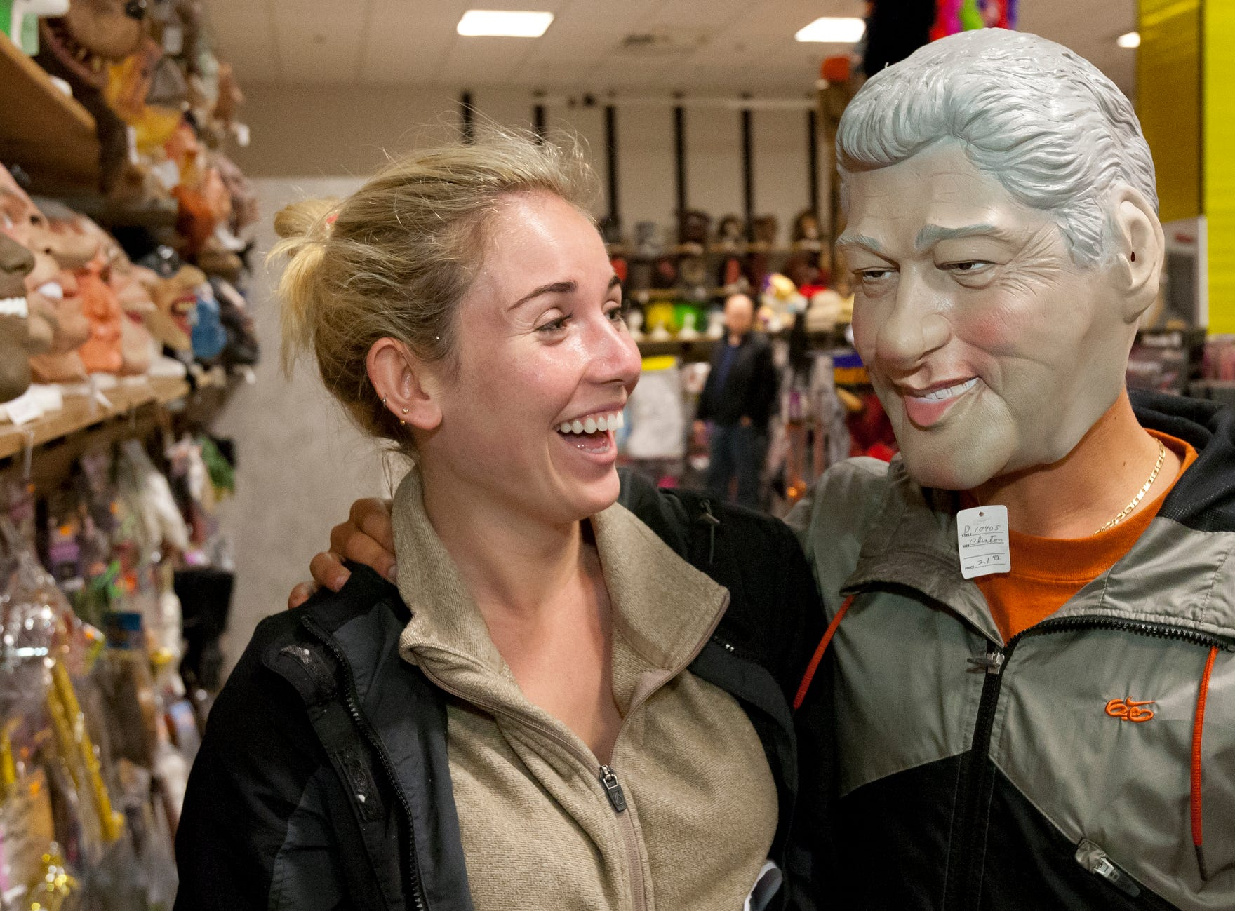 2013: Sarah Greenberg, a Cornell University junior from San Clemente Calif. shops for Halloween masks with her boyfriend Joe Maltese, who was visiting from San Clemente, at the Costume Place at The Shops at Ithaca Mall.