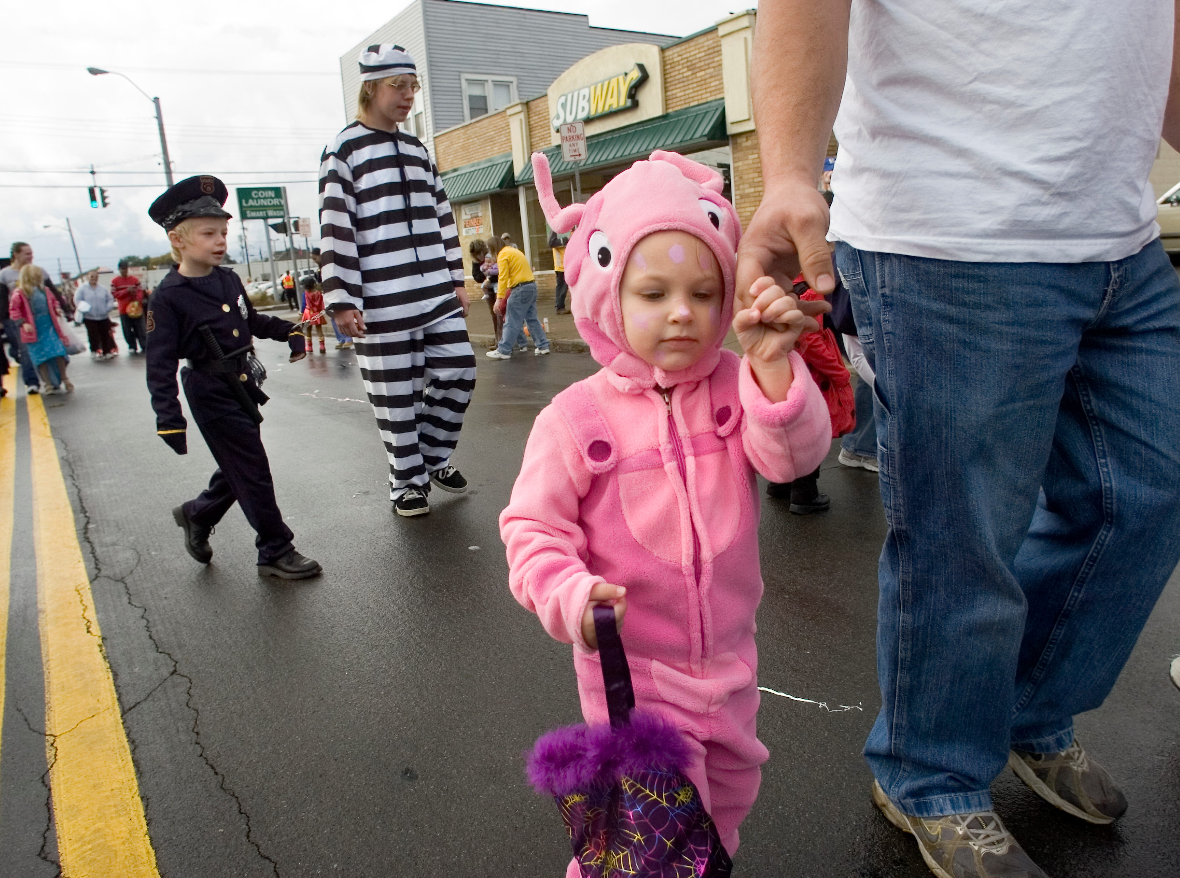 2005: Two-year-old Andrea Medovich of Binghamton dons a Uniqua costume Saturday during the youth Halloween parade on Robinson Street in Binghamton. The event was part of Make A Difference Day.
