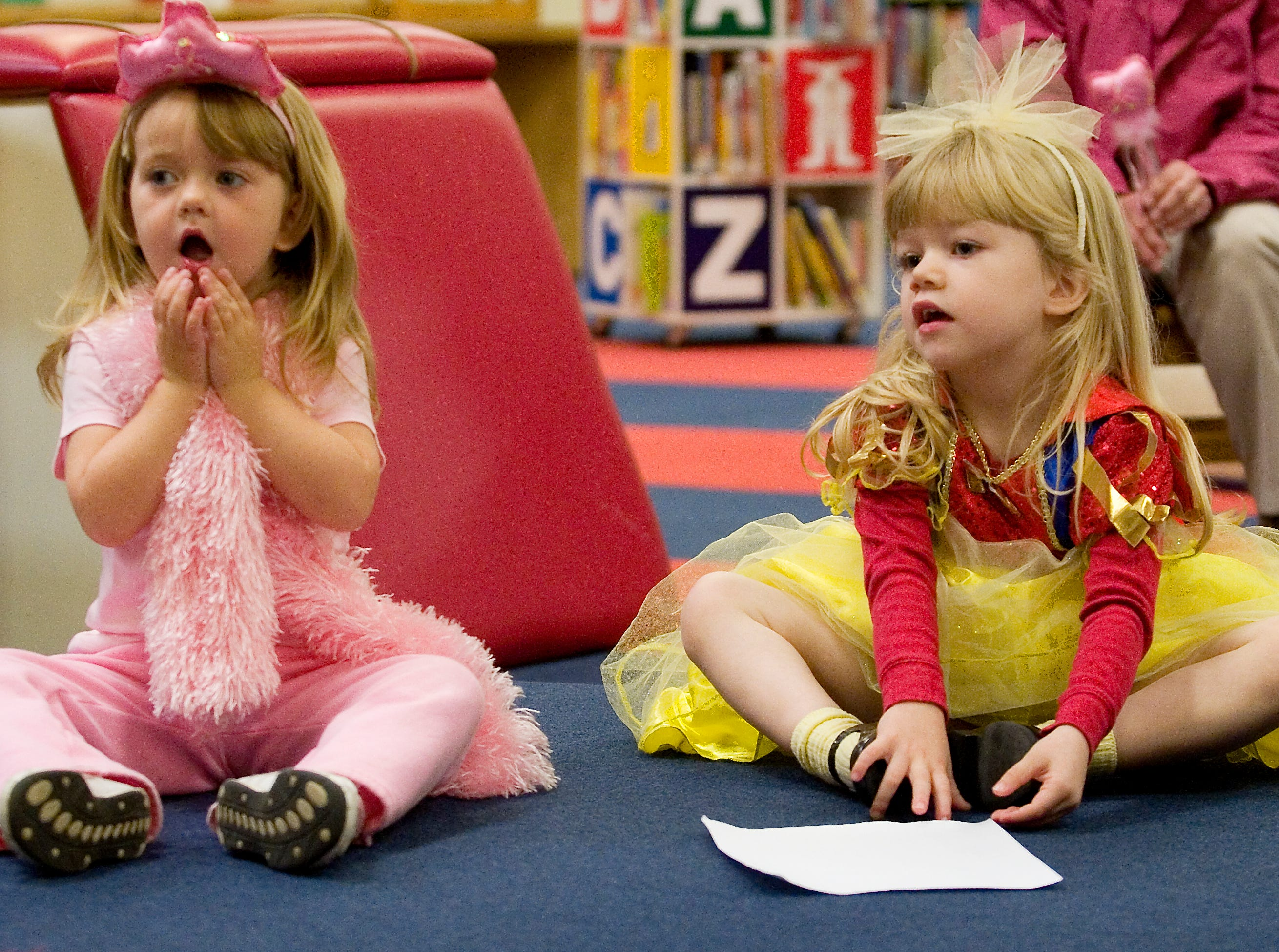2009: Abigail Bennett and Mallory Sheehan, both 3, listen to Halloween tales at Steele Memorial Library in Elmira Friday morning.