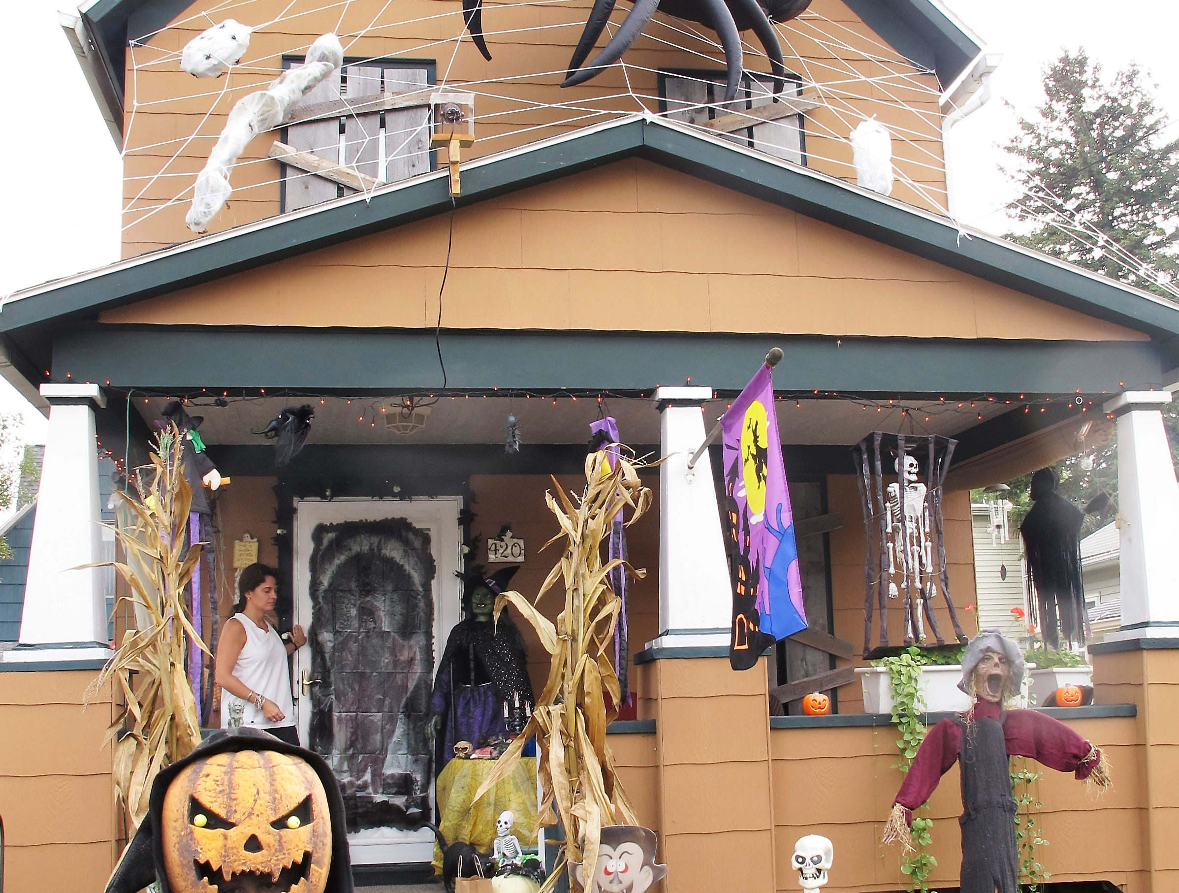 2010: Chase Miller, 9, dressed as the Grim Reaper, stands in front of the Halloween display at his home on East Third Street in Corning. His mother Amy is standing on the porch.
